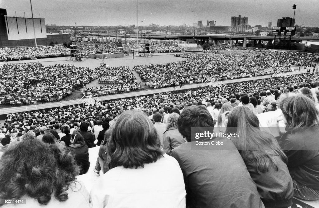 Thousands fill Boston University's Nickerson Field for the first day of Reverend Billy Graham's eight-day crusade in Boston on May 30, 1982.
