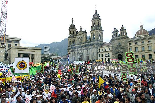 Thousands gather at Bolivar's square during a May Day march May 1 2002 in Bogota Colombia