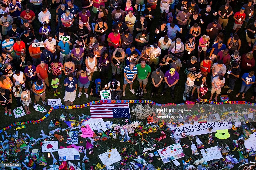 Thousands gather at the Dr. Phillips Center for the Performing Arts to pay their respects for those lost in the Pulse nightclub shooting in Orlando, USA on June 13, 2016.