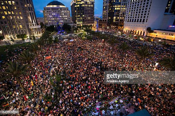 Thousands gather at the Dr Phillips Center for the Performing Arts to pay their respects for those lost in the Pulse nightclub shooting in Orlando...