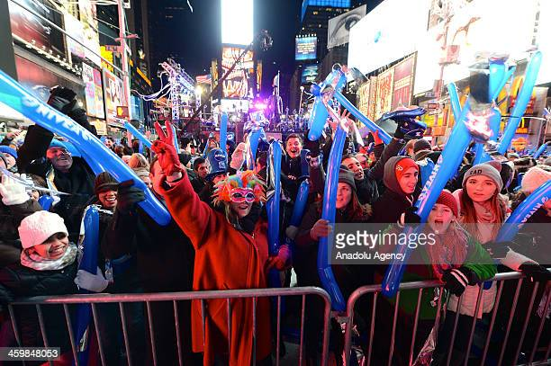 Thousands gather in New York's Times Square to celebrate the ball drop during the annual New Years Eve celebration on January 12014 in New York City