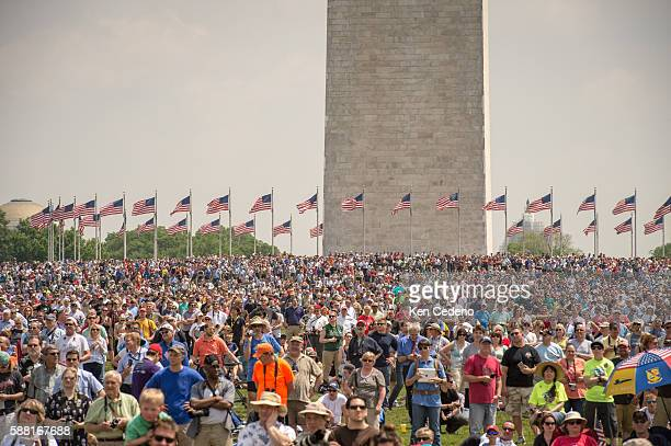 Thousands gather on the National Mall during an array of other World War II aircraft ever assembled to fly over the National Mall celebrating the...