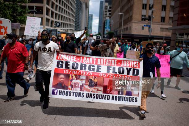 Thousands gather to protest and mourn George Floyd a black man who died after a white policeman kneeled on his neck for several minutes during the...