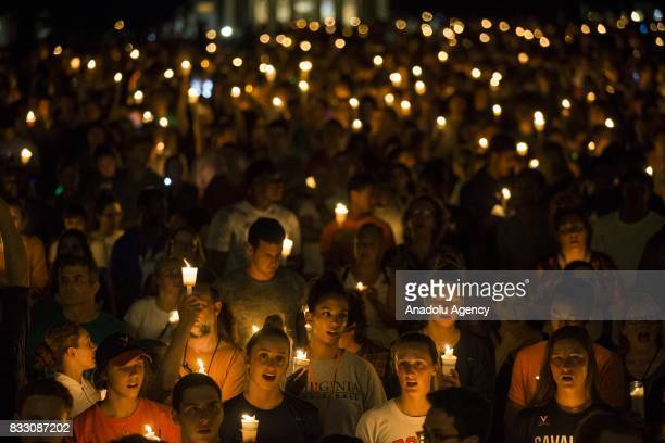 Thousands gather with candles to march along the path that White Supremacists took the prior Friday with torches on the University of Virginia Campus...