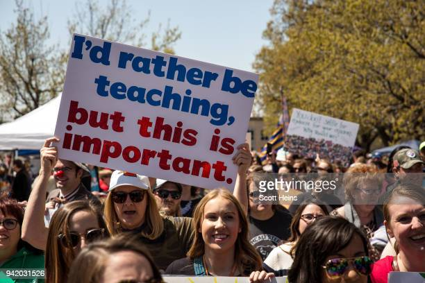 Thousands gathered and marched in a pitcket line outside the Oklahoma state Capitol building during the third day of a statewide education walkout on...