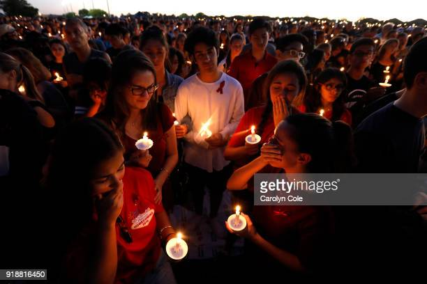 Thousands gathered for an evening vigil at Pine Trails Park in Parkland Florida to remember those where were killed and injured in the shooting on...