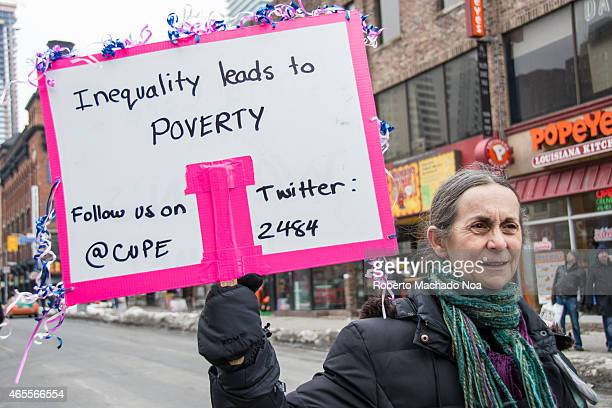 STREET TORONTO ONTARIO CANADA Thousands gathered in Toronto to mark International Womens Day with a large protest march inequality leading to poverty...