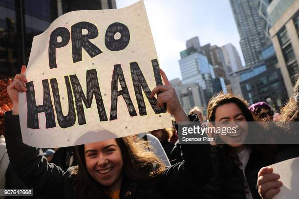 Thousands hold signs and rally while attending the WomenÕs March on January 20 2018 in New York United States Across the nation hundreds of thousands...