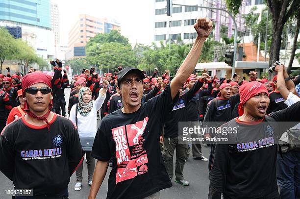 Thousands Indonesian workers and labor unions during a protest demanding higher wages on October 31 2013 in Surabaya Indonesia Several Indonesian...