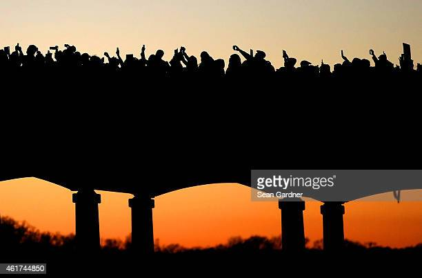 Thousands march across the Edmund Pettus Bridge along with members of the cast of the movie Selma in honor of Rev Martin Luther King Jr Day on...