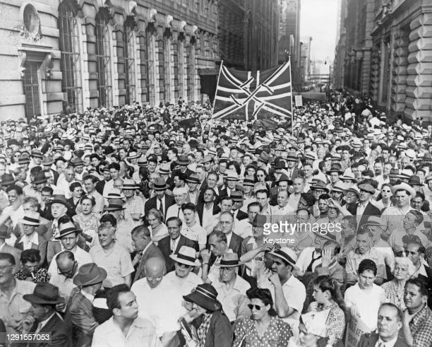 Thousands march beneath a Union Jack flag adorned with a swastika during a demonstration to 'Fight Britain's Tyranny in Palestine' in New York City,...