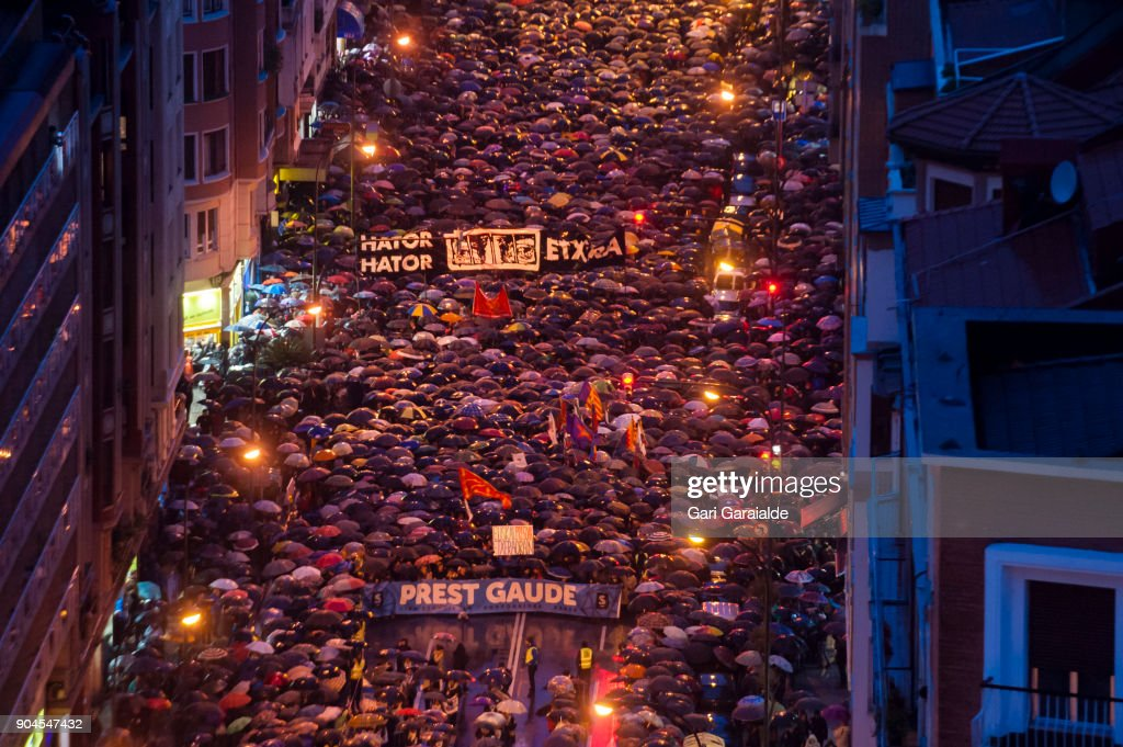 Thousands march during a demonstration organised by the citizen's network which is calling for an immediate end to the dispersal policy and the violation of rights suffered by Basque prisoners on January 13, 2018 in Bilbao, Spain. The banner reads in Basque 'we are ready'. Families of prisoners from the disbanded terrorist group ETA protest for their right to be moved to prisons that would make visiting easier.