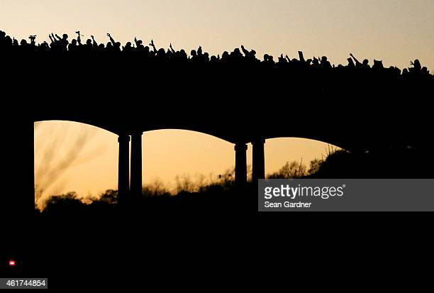 Thousands marched across the Edmund Pettus Bridge along with members of the cast of the movie Selma in honor of Rev Martin Luther King Jr Day on...