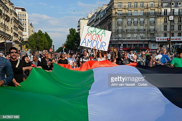 Thousands marched peacefully in the streets of Paris to demonstrate against Israel's offensive on Gaza Demonstrators brandished Palestinian flags and...
