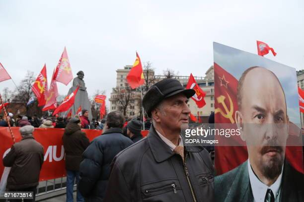 Thousands marched to Revolution Square in central Moscow to commemorate the 100th anniversary of the Russian Revolution Many carried portraits of...