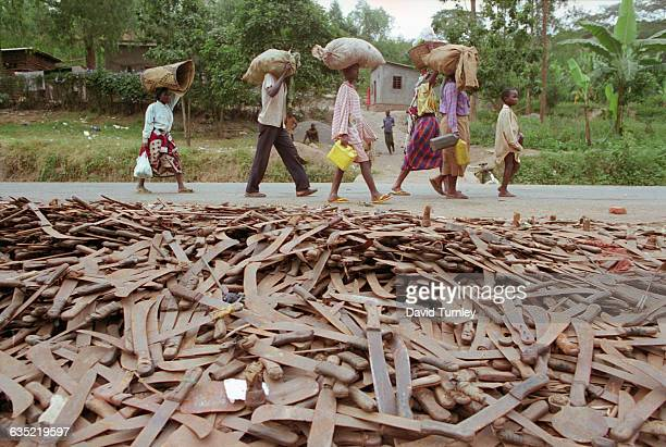 Thousands of abandoned machetes collect at the border of Rwanda and Tanzania, where Hutu refugees fleeing Rwanda are allowed across the border on the...