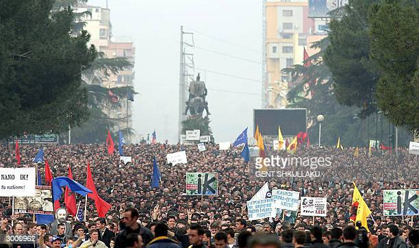 Thousands of Albanians demonstrate 21 February 2004 in Tirana for the ouster of Prime Minister Fatos Nano accusing him of being responsible for...