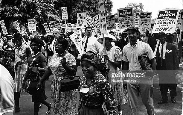 Thousands of Americans march near the Lincoln Memorial August 28, 1963 at a civil rights rally.