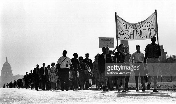 Thousands of Americans march near the U.S. Capitol August 28, 1963 at a civil rights rally.