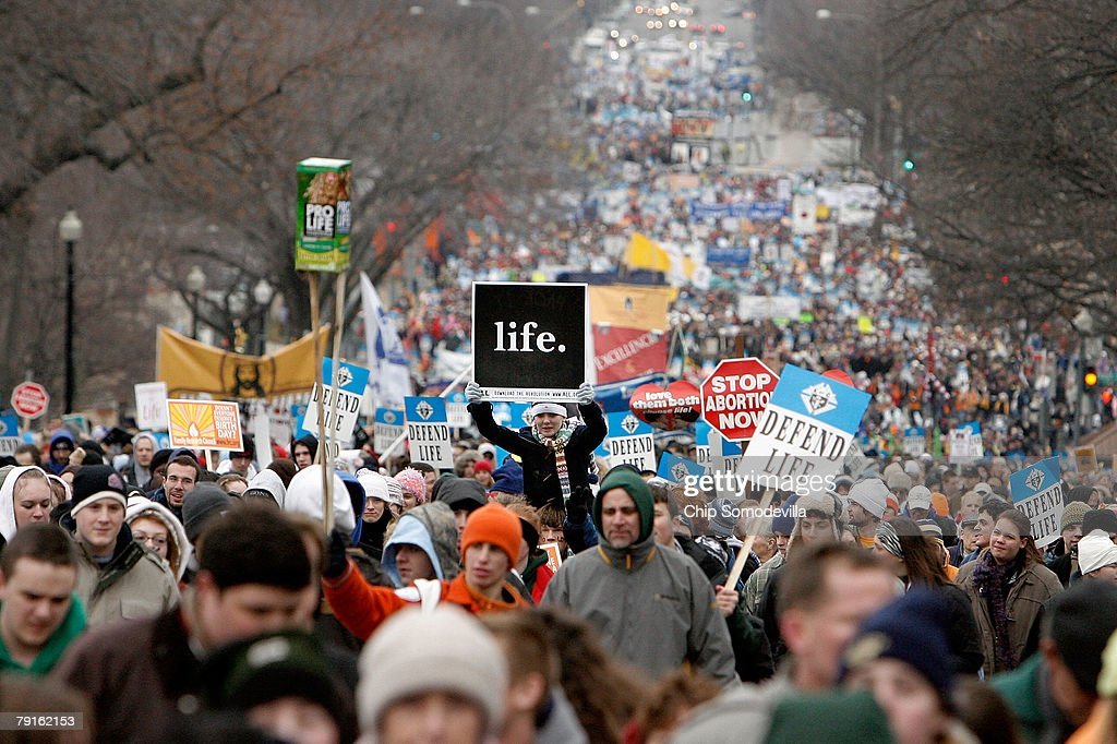 Thousands of anti-abortion demonstrators participating in the 'March for Life' walk up to Capitol Hill along Constitution Avenue on their way to the Supreme Court building January 22, 2008 in Washington, DC. The march marks the 35th anniversary of the Supreme Court's landmark Roe v. Wade decision that legalized abortion in the United States.