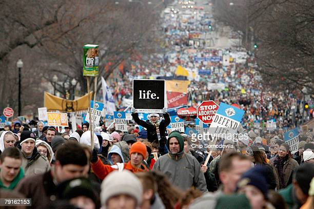 Thousands of antiabortion demonstrators participating in the 'March for Life' walk up to Capitol Hill along Constitution Avenue on their way to the...