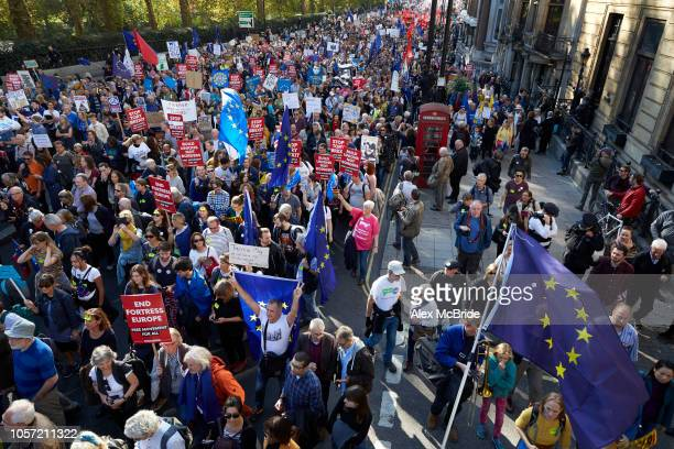 Thousands of antiBrexit protestors march along Piccadilly on in London UK More than one hundred thousand people march from Park Lane to Parliament...
