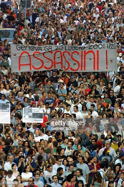 Thousands of antiglobalisation protesters opposed to the government's handling of riots that marred a Group of Eight summit in Genoa last week march...