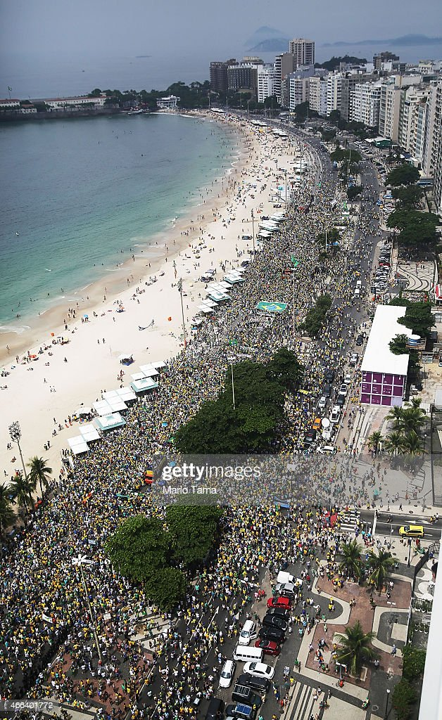 Thousands of anti-government protesters march along Copacabana beach on March 15, 2015 in Rio de Janeiro, Brazil. Protests across the country were held today against President Dilma Rousseff's government with many protesters calling for her impeachment. A massive corruption scandal at Brazil's state-owned oil company Petrobras has rocked the government and Dilma's approval ratings are now around 23 percent. Brazil's inflation rate has hovered around ten-year highs recently while the currency, the Brazilian real, has passed twelve-year lows when measured against the U.S. dollar.