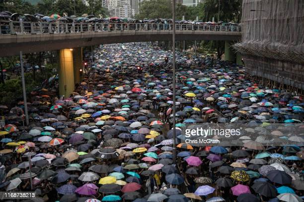 Thousands of anti-government protesters march on a street after leaving a rally in Victoria Park on August 18, 2019 in Hong Kong, China....