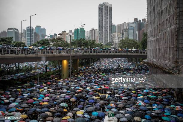 Thousands of antigovernment protesters march on a street after leaving a rally in Victoria Park on August 18 2019 in Hong Kong China Prodemocracy...