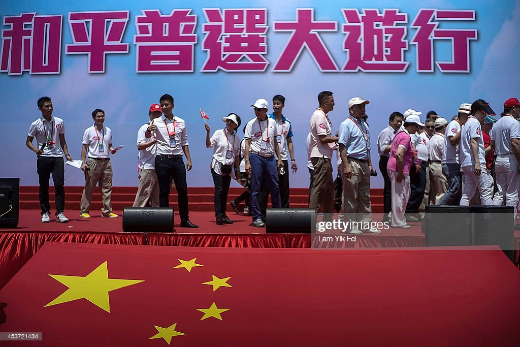 Anti-Occupy Central Stages A 'Walk For Peace And Universal Suffrage' : News Photo