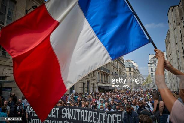 Thousands of Anti-Vaccine demonstrators march through the streets of Paris in protest to new restrictions announced by French President Emmanuel...