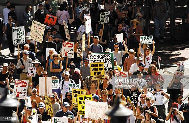 Thousands of antiwar activists walk up Powell Street as they get ready to converge onto Union Square to protest a possible war in Iraq October 6 2002...