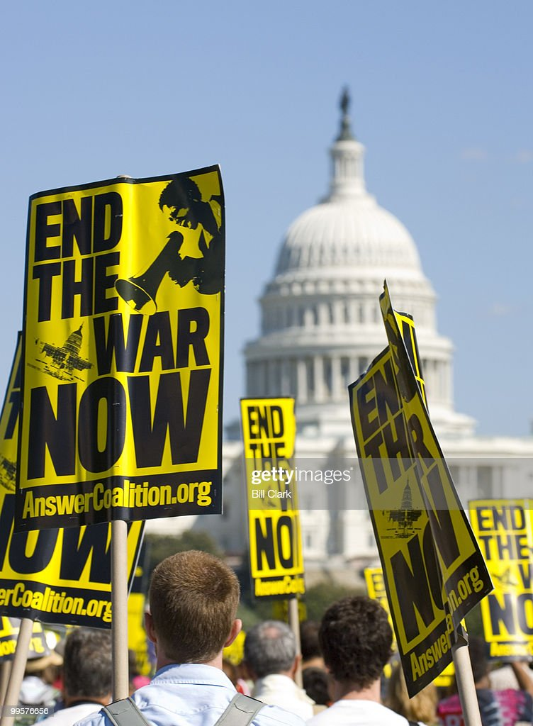 Thousands of anti-war demonstrators march from the White House to the Capitol on Saturday, Sept. 15, 2007.