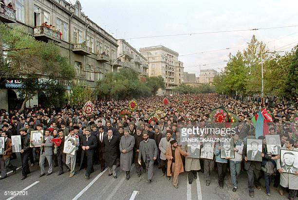 Thousands of Azeri demonstrators gather in Baku 26 November 1991 to protest against Armenia following the crash in Nagorny Karabakh 20 November of a...