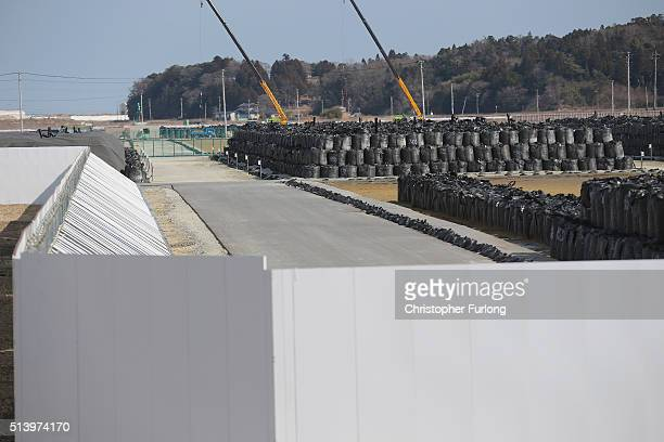Thousands of bags of radiation contaminated soil and debris wait to be processed inside the exclusion zone close to the devastated Fukushima Daiichi...