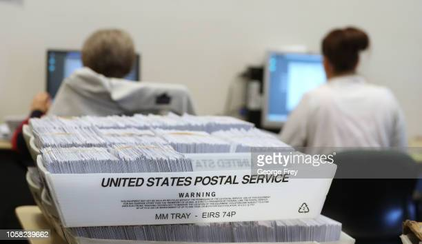 Thousands of ballots sit in boxes as Utah County election workers process the mailin ballots for the midterm elections on November 6 2018 in Provo...
