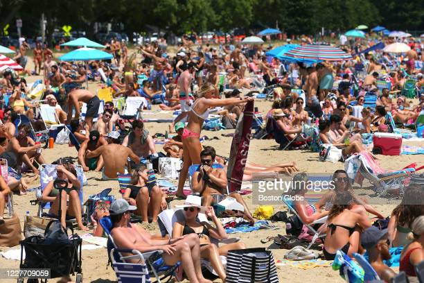 Thousands of beachgoers pack M Street Beach in South Boston on July 18, 2020.