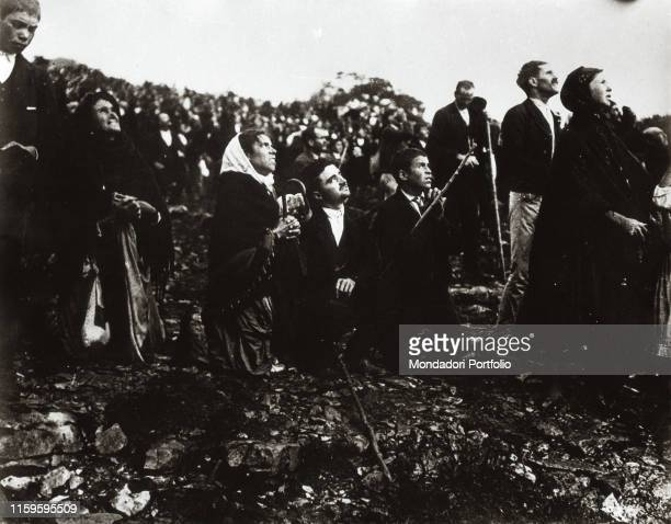 Thousands of believers attending the Miracle of the Sun where the Virgin appeared Fatima Portugal 13th October 1917