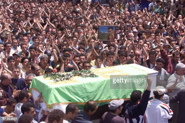 Thousands of Berber people attend 27 May 2001 in Takriet near Bejaia in the Kabylie region home to the Berber ethnic minority the funeral of a...