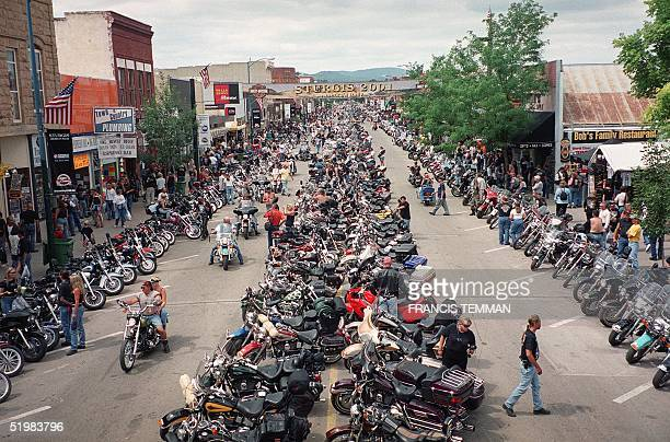 Thousands of bikers crowd main street during the 61st annual motorcycle rally held 0612 August 2001 in Sturgis South Dakota Thousands of bikers from...