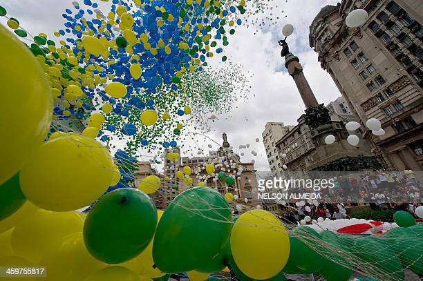 Thousands of biodegradable balloons are released by members of the city's commercial association at Patio do Colegio, the site of the city's...