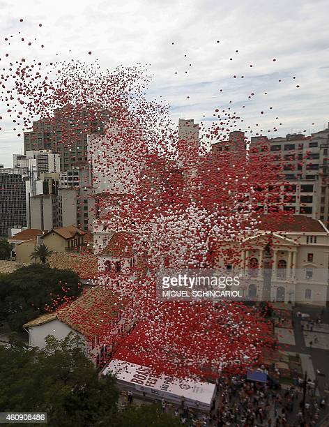 Thousands of biodegradable balloons are released by members of the Sao Paulo's commercial association at Patio do Colegio, the site of this Brazilian...