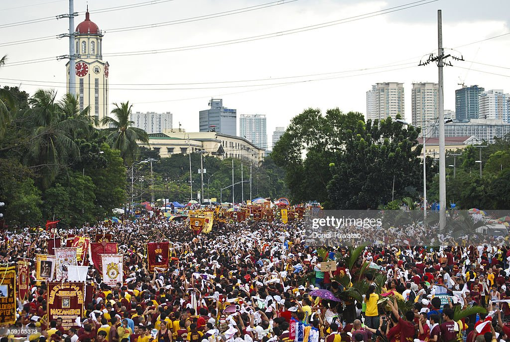 Thousands of Black Nazarene devotees try to get near the carriage carrying the Black Nazarene during the 406th feast of The Black Nazarene on January 9, 2013 in Manila, Philippines. Devotees march barefoot as a sign of sacrifice during the procession as the Black Nazarene is carried in turn through Manila's thouroughfares. The dark wood sculpture of Jesus was brought to the Philippines in the 1600s by Spanish missionaries from Mexico to the Philippines and is revered by Catholic devotees who claim the statue possess miraculous powers. Security authorities monitoring the day long procession estimated the crowd at around 2 million people at its peak.