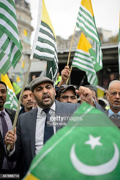 Thousands of Britishbased Kashmiris and Pakistanis wave the Kashmiri flag and chat slogans as they protest in Trafalgar Square in central London on...