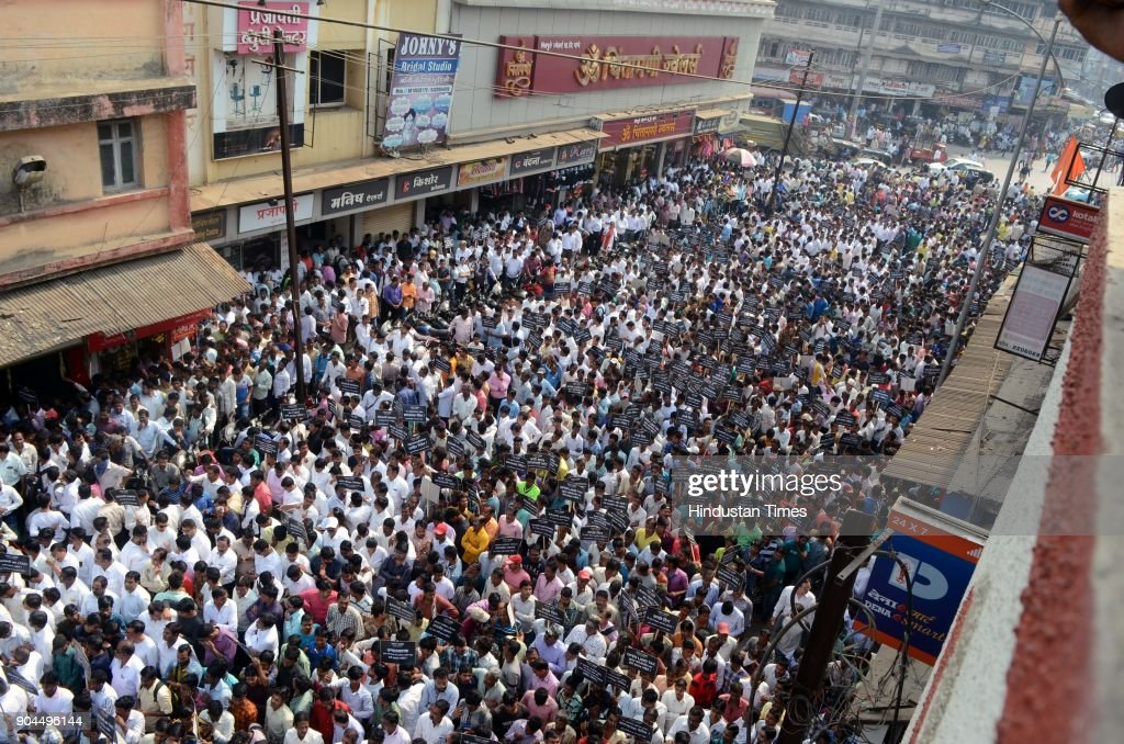 Thousands of builders, construction workers and architectures thronged the headquarters of Kalyan-Dombivli Municipal Corporation (KDMC) on Friday to protest the open land tax (OLT) imposed by the civic body, on January 12, 2018 in Mumbai, India. The builders walked from Sahajanand in Kalyan (West) to KDMC headquarters.
