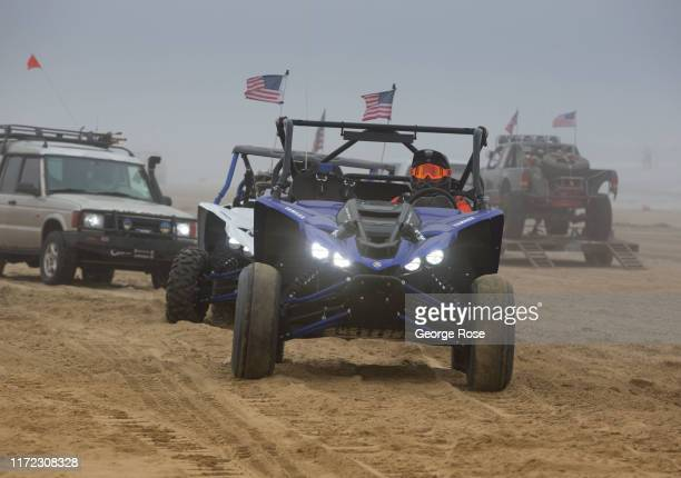 Thousands of campers jam the sandy beach at Oceano Dunes State Vehicular Area under a thick Labor Day Weekend fog on August 31 near Pismo Beach,...