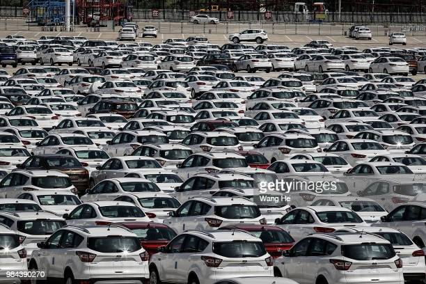 Thousands of cars part at the Wuhan Hannan port on the Yangtze River on June 26 2018 in WuhanHubei province China Wuhan New Port comprises four ports...