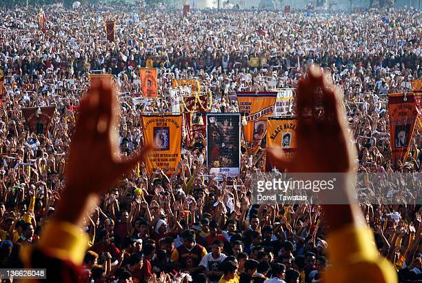 Thousands of Catholic devotees join the procession during the 405th Feast of the Black Nazarene on January 9 2012 in Manila Philippines Devotees take...