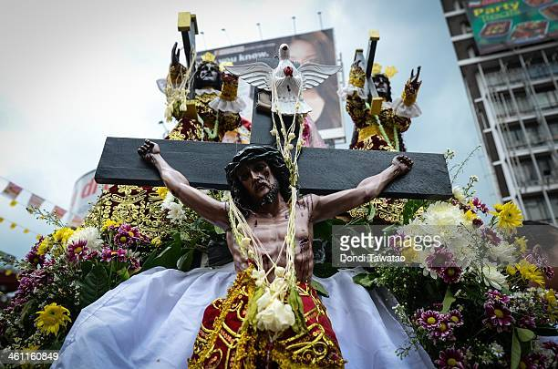 Thousands of Catholic devotees of the Black Nazarene converge in the streets of Manila on January 7 2014 in Quiapo district Manila Philippines The...